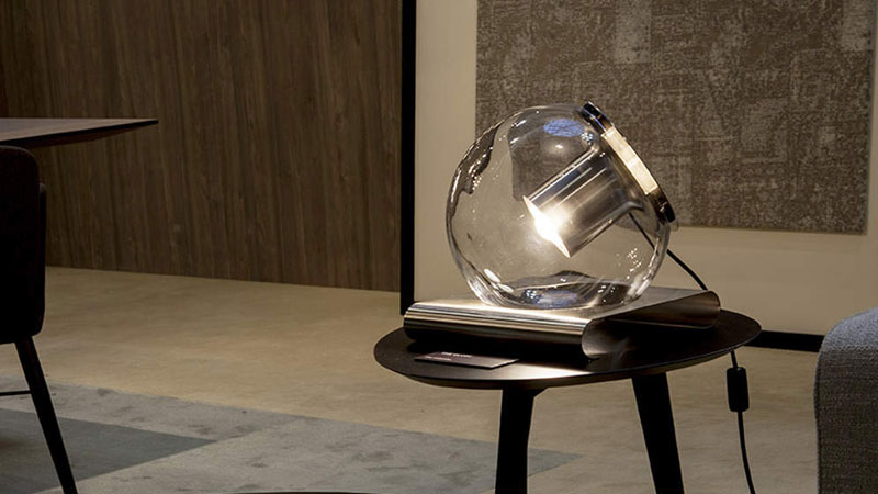 The Globe designed by Joe Colombo. Table lamp with direct and diffused light. Made of clear blown glass